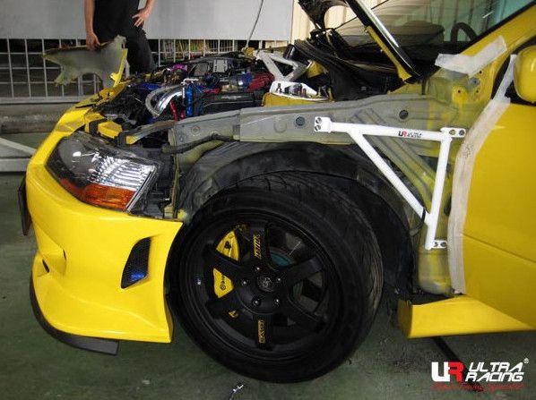 Rozpěrná tyč Ultra Racing Mitsubishi Lancer Evo 7/8/9 - přední výztuhy pod blatníky